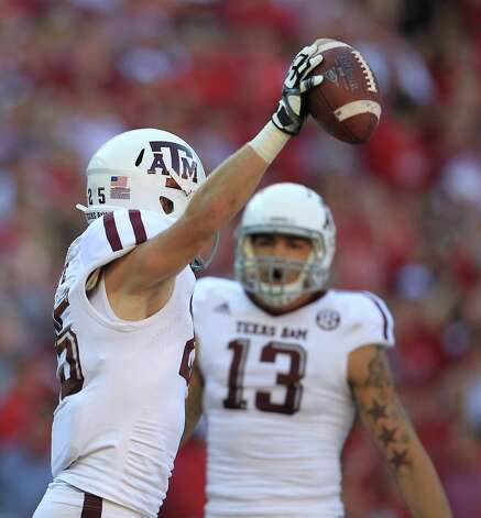 Texas A&M wide receiver Ryan Swope (25) celebrates his touchdown catch in the end zone during the first quarter of a college football game at Bryant-Denny Stadium, Saturday, Nov. 10, 2012, in Tuscaloosa. Photo: Karen Warren, Houston Chronicle / © 2012  Houston Chronicle