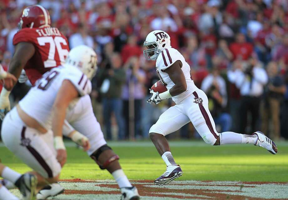Texas A&M linebacker Sean Porter (10) runs the interception on a pass intended for Alabama wide receiver Kenny Bell (7) during the first quarter of a college football game at Bryant-Denny Stadium, Saturday, Nov. 10, 2012, in Tuscaloosa. Photo: Karen Warren, Houston Chronicle / © 2012  Houston Chronicle