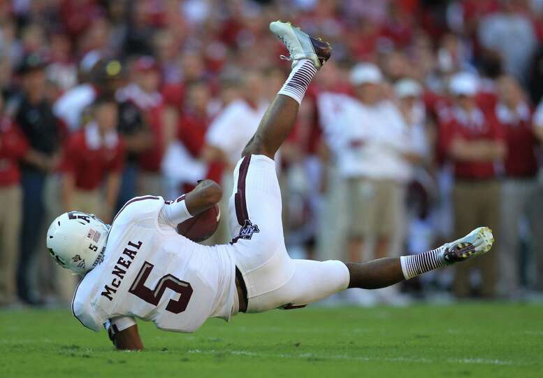 Texas A&M wide receiver Kenric McNeal (5) falls to the ground after making a catch during the first
