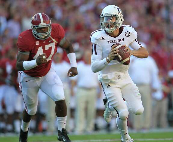 Texas A&M quarterback Johnny Manziel (2) scrambles for yardage during the first quarter of a college football game at Bryant-Denny Stadium, Saturday, Nov. 10, 2012, in Tuscaloosa. Photo: Karen Warren, Houston Chronicle / © 2012  Houston Chronicle