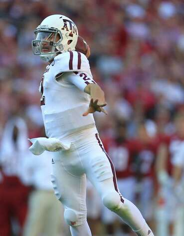 Texas A&M quarterback Johnny Manziel (2) throws a touchdown pass to Texas A&M wide receiver Ryan Swope (25) during the first quarter of a college football game at Bryant-Denny Stadium, Saturday, Nov. 10, 2012, in Tuscaloosa. Photo: Karen Warren, Houston Chronicle / © 2012  Houston Chronicle