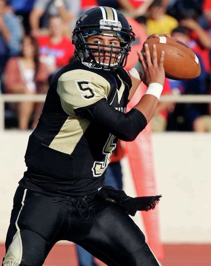 Edison's Zack Garcia looks to pass against Jefferson during second half action of the Tommy Bowl Saturday Nov. 10, 2012 at Alamo Stadium. Jefferson won 30-13. Photo: Edward A. Ornelas, Express-News / © 2012 San Antonio Express-News