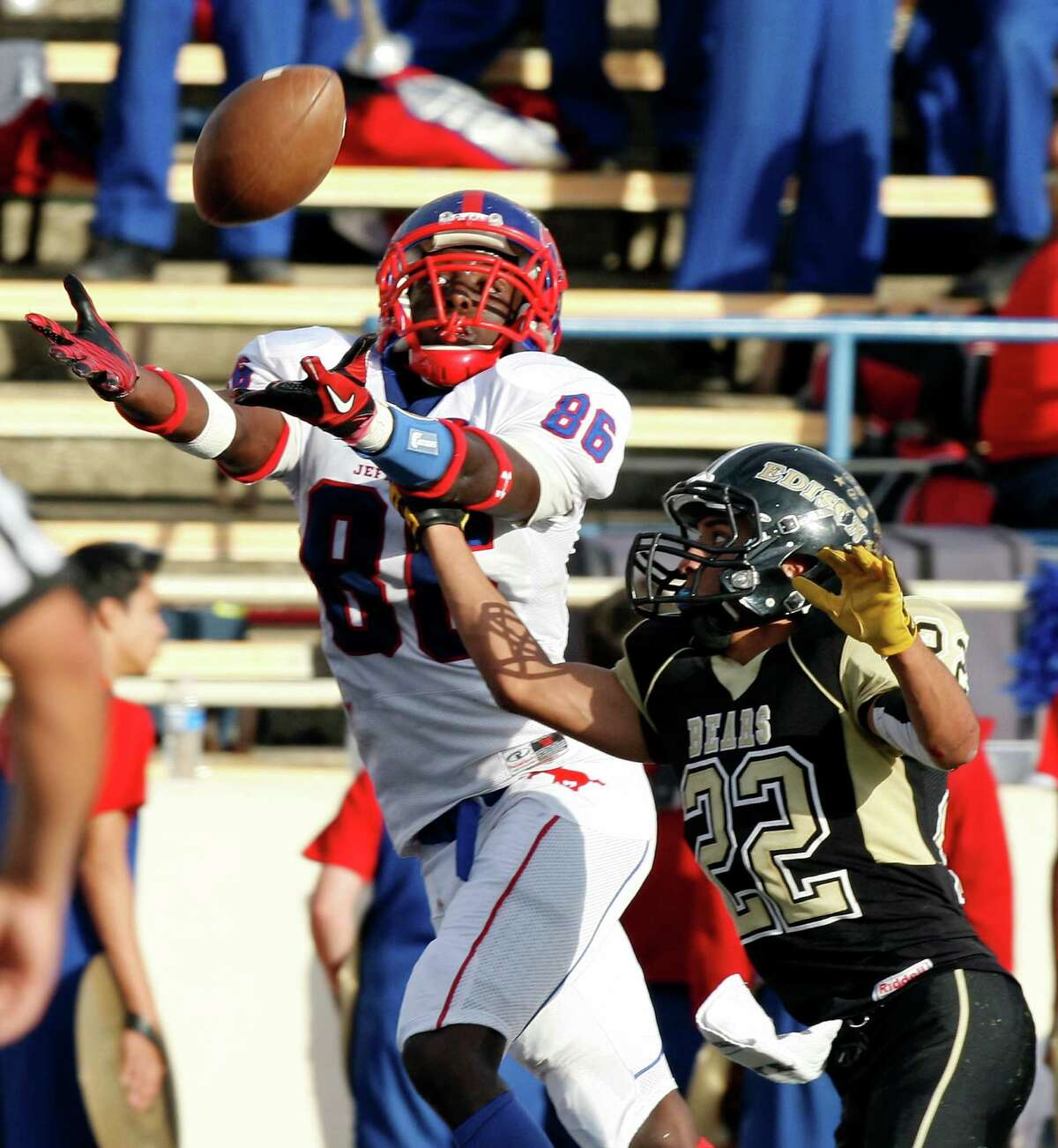 Jefferson's Maurice Hudspeth goes up for a pass as he is defended by Edison's Stephen Gomez during second half action of the Tommy Bowl Saturday Nov. 10, 2012 at Alamo Stadium. The pass was incomplete. Jefferson won 30-13.
