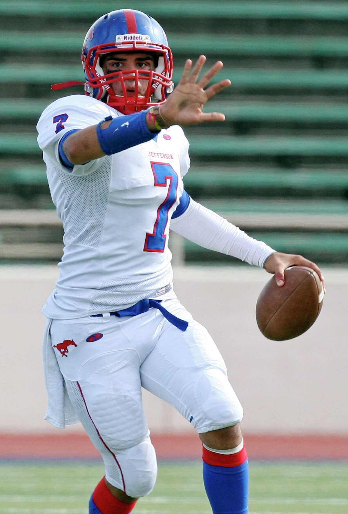 Jefferson's Jorge Flores looks to pass against Edison during first half action of the Tommy Bowl Saturday Nov. 10, 2012 at Alamo Stadium.