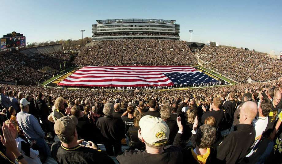 Veterans from the University of Iowa unfurl a field-sized U.S. flag for Veterans Day before Iowa's NCAA college football game against Purdue on Saturday, Nov. 10, 2012, in Iowa City, Iowa. Purdue won 27-24. Photo: Brian Ray, Associated Press / The Gazette