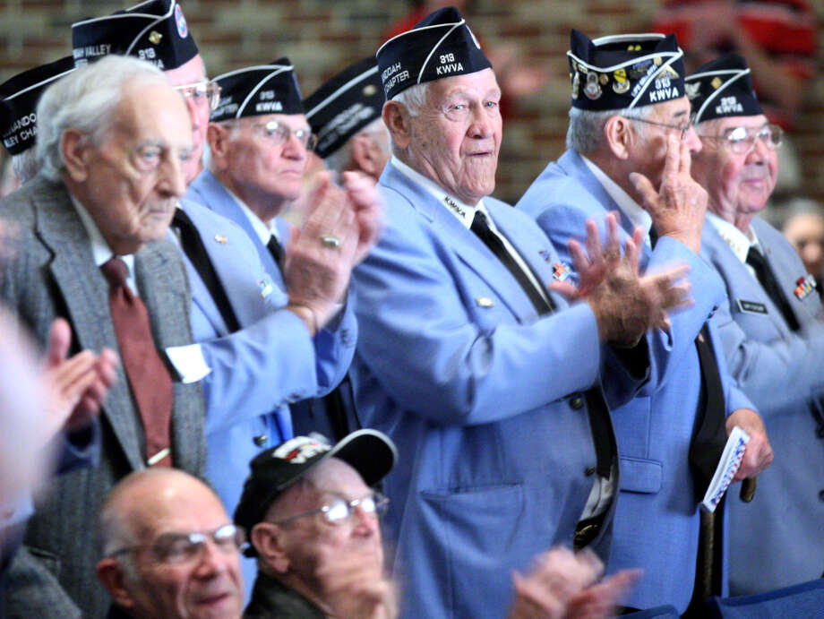 Korean War veterans from the Winchester, Va., area applaud as they are honored Friday Nov. 9, 2012 during the 5th Annual Veteran's Day Celebration at Millbrook High School. Photo: Jeff Taylor, Associated Press / THE WINCHESTER STAR