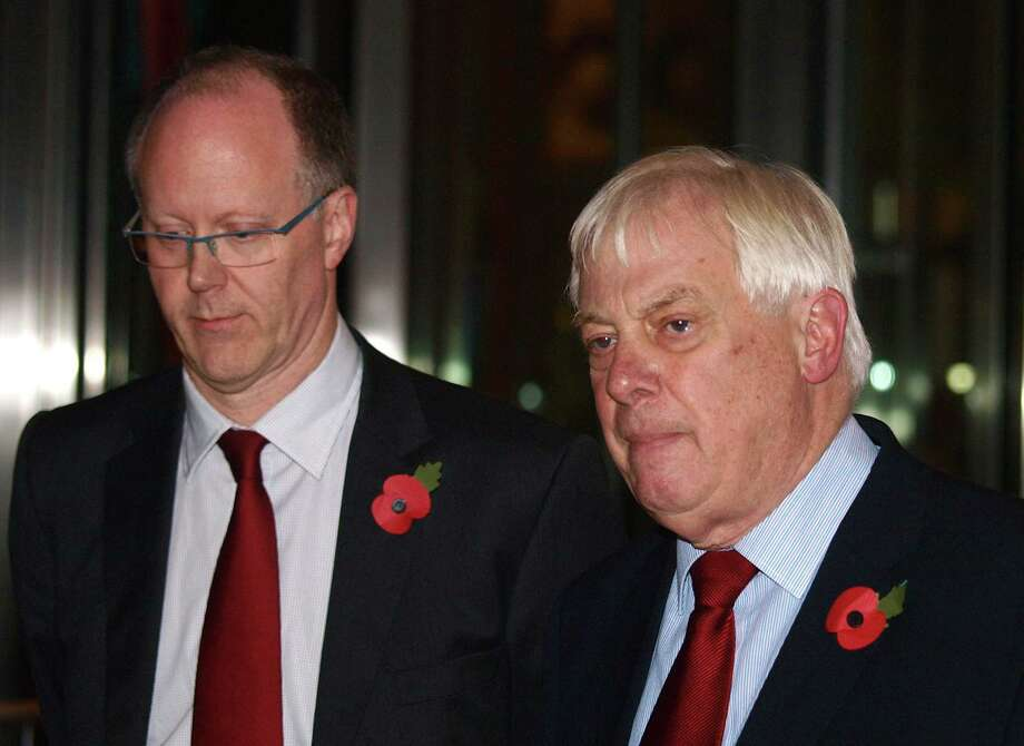 George Entwistle, left, resigned Saturday, flanked by Lord Chris Patten, chairman of the BBC Trust. Photo: MAX NASH, STR / AP