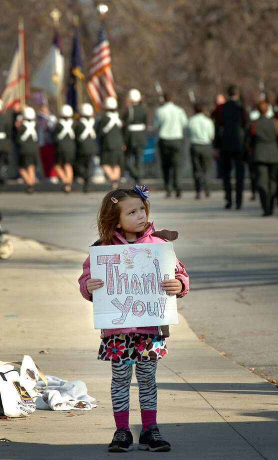 Avalee Powell, 5, watches the annual Veterans' Day parade in Fort Wayne, Ind. Saturday, Nov 10, 2012. Photo: Samuel Hoffman, Associated Press / The Journal-Gazette