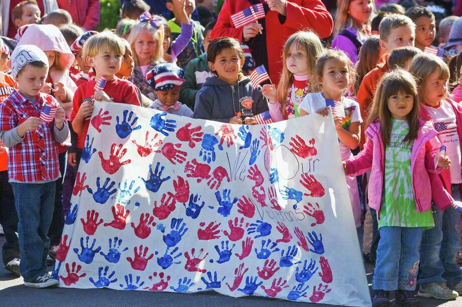 Kenwood Elementary School students listen to a speaker during the schoolís annual Veterans Day celebration, Friday, Nov. 9, 2012, in Fort Walton Beach, Fla. Photo: Mark Kulaw, Associated Press / Northwest Florida Daily News