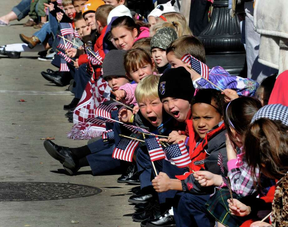 Children watch the annual Veterans Day Parade on Friday, Nov. 9, 2012 in Knoxville, Tenn. Photo: Michael Patrick, Associated Press / Knoxville News Sentinel