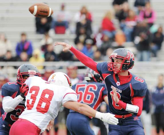Brien McMahon quarterback Matt Downey # 6 throws the ball while being pressured by Dan Claroni # 38 of Greenwich during the high school football game between Brien McMahon and Greenwich at Brien McMahon High School in Norwalk, Saturday afternoon, Nov. 10, 2012. Photo: Bob Luckey / Greenwich Time
