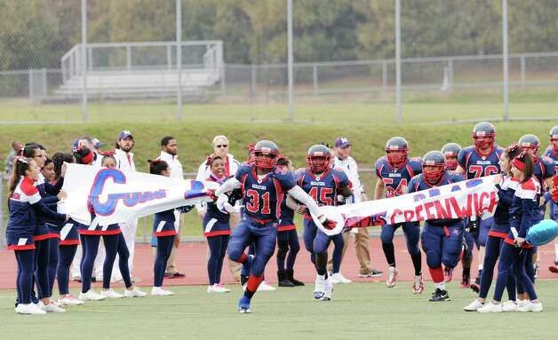Kyle Jordan # 31 of Brien McMahon leads his team into the field during the high school football game between Brien McMahon and Greenwich at Brien McMahon High School in Norwalk, Saturday afternoon, Nov. 10, 2012. Photo: Bob Luckey / Greenwich Time