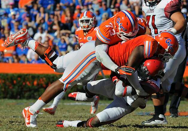 GAINESVILLE, FL - NOVEMBER 10: Defensive lineman Sharrif Floyd #73 of the Florida Gators tackles running back Alonzo Harris #46 of the Louisiana-Lafayette Ragin' Cajuns November 10, 2012 in Gainesville, Florida. Florida won 27 - 20. (Photo by Al Messerschmidt/Getty Images) Photo: Al Messerschmidt, Getty Images