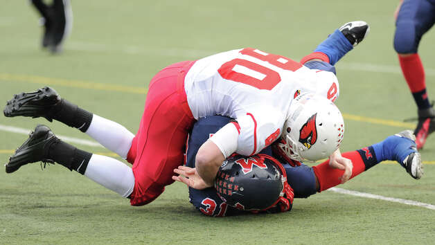 Joe Kelly # 80 of Greenwich tackles Kyle Jordan # 31 of Brien McMahon during the high school football game between Brien McMahon and Greenwich at Brien McMahon High School in Norwalk, Saturday afternoon, Nov. 10, 2012. Photo: Bob Luckey / Greenwich Time