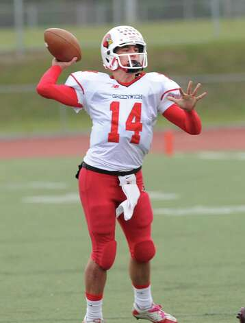 LIam O'Neil # 14, the Greenwich High School quarterback, throws during the football game between Brien McMahon and Greenwich at Brien McMahon High School in Norwalk, Saturday afternoon, Nov. 10, 2012. Photo: Bob Luckey / Greenwich Time