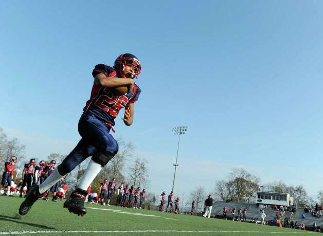 Kenneth Keen # 26 of Brien McMahon warms-up prior to the high school football game between Brien McMahon and Greenwich at Brien McMahon High School in Norwalk, Saturday afternoon, Nov. 10, 2012. Photo: Bob Luckey / Greenwich Time