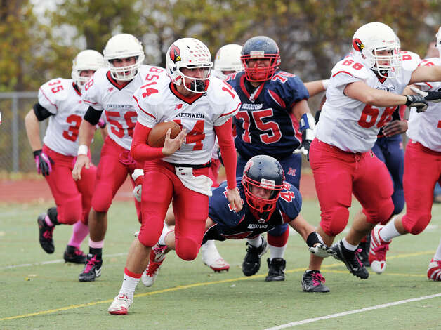 Liam O'Neil # 14 of Greenwich breaks out of the pocket to run the ball during the high school football game between Brien McMahon and Greenwich at Brien McMahon High School in Norwalk, Saturday afternoon, Nov. 10, 2012. Photo: Bob Luckey / Greenwich Time