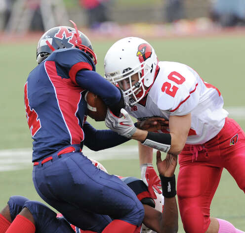 At left, Trevon Fomey of Brien McMahon gets tackled by Shawn Dunster # 20 of Greenwich High School during football game between Brien McMahon and Greenwich at Brien McMahon High School in Norwalk, Saturday afternoon, Nov. 10, 2012. Photo: Bob Luckey / Greenwich Time