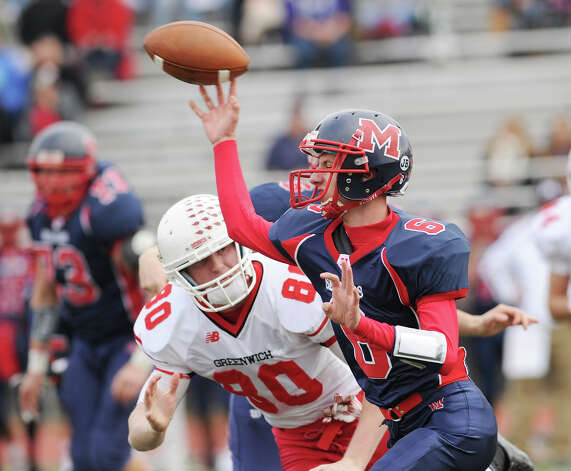 Q.B. Matt Downey of Brien McMahon throws while being pressured by Joe Kelly # 80 of Greenwich during the High School football game between Brien McMahon and Greenwich at Brien McMahon High School in Norwalk, Saturday afternoon, Nov. 10, 2012. Photo: Bob Luckey / Greenwich Time