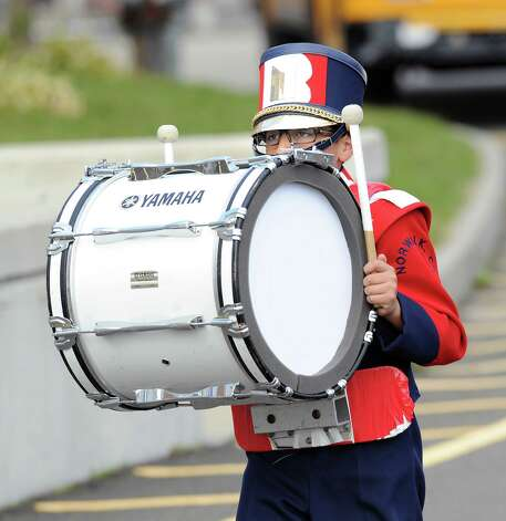 Brien McMahon High School band member Josue Armas, 14, carries his bass drum during the high school football game between Brien McMahon and Greenwich at Brien McMahon High School in Norwalk, Saturday afternoon, Nov. 10, 2012. Photo: Bob Luckey / Greenwich Time