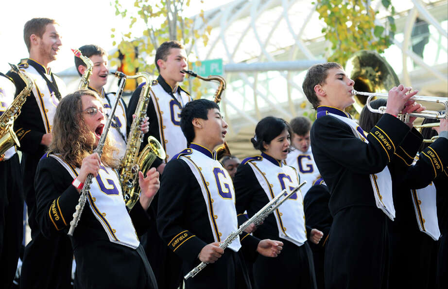 Members of the Garfield High School Band play spiritedly  outside before the Space Shuttle Trainer G