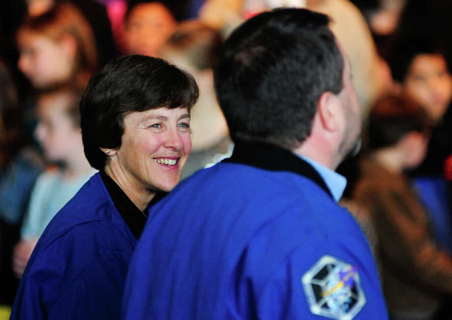 Former NASA astronauts Wendy Lawrence and Nicholas Patrick speak to the gathered crowd in front of the Space Shuttle Trainer during the exhibit's Grand Opening at the Museum of Flight's Charles Simonyi Space Gallery on Saturday, November 10, 2012. The public was given its first look inside the one-of-a-kind NASA Space Shuttle Trainer, which each of the space shuttle astronauts trained in before operating the real craft. Photo: LINDSEY WASSON / SEATTLEPI.COM