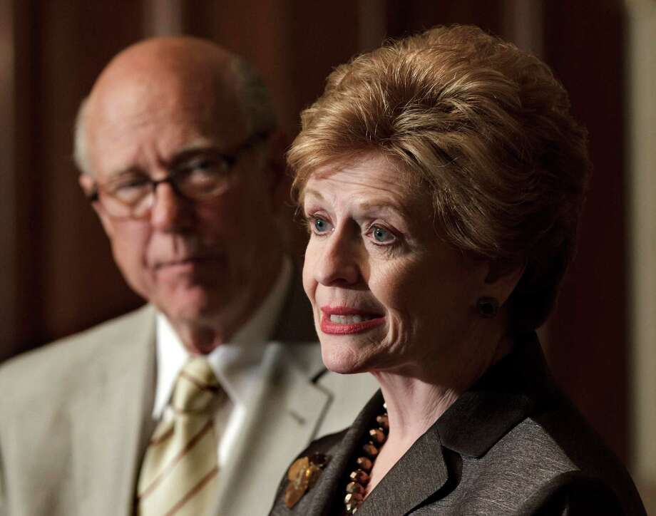FILE - In this June 6, 2012 file photo, Sen. Pat Roberts, R-Kansas, ranking Republican on the Senate Agriculture Committee, listens at left as Committee Chair Sen. Debbie Stabenow, D-Mich. speaks about the farm bill during a news conference on Capitol Hill in Washington.  (AP Photo/J. Scott Applewhite) Photo: J. Scott Applewhite