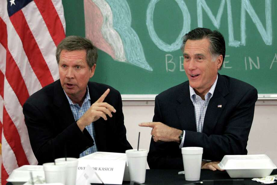 FILE - In this April 27, 2012 file photo, former Massachusetts Gov. Mitt Romney, right, and Ohio Gov. John Kasich participate in a roundtable discussion in Westerville, Ohio. No matter how long the nation's unemployment rate hovered around 8 percent, the Northeast and the West Coast were never in doubt for President Barack Obama. No matter how far it might have fallen before Election Day, Mitt Romney was always sure to win the South and rural Great Plains. Nothing was so certain in the Midwest. Tuesday's results reaffirmed the future of the Midwest as a political battleground where voters willing to look past party will decide the outcome of elections. (AP Photo/Jae C. Hong, File) Photo: Jae C. Hong