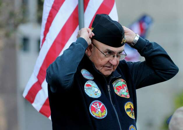 Submarine veteran Lawrence Check, who served  on the USS Sam Houston, adjusts his garrison cap during the 31st annual Veterans Day Parade in downtown Atlanta, Saturday, Nov. 10, 2012. (AP Photo/David Tulis) Photo: David Tulis