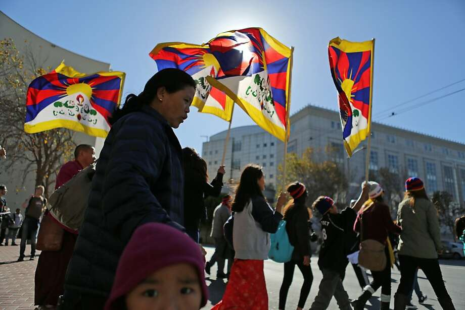 Pro-Tibetan demonstrators accuse China of repression during a march at U.N. Plaza in S.F. At least 69 dissidents have set themselves on fire in recent rallies. Photo: Rashad Sisemore, The Chronicle