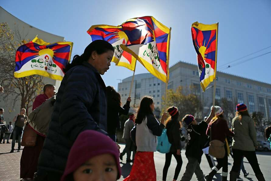 Pro-Tibetan demonstrators accuse China of repression during a march at U.N. Plaza in S.F. At leas