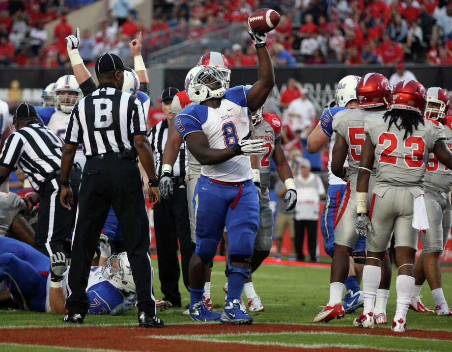 University of Tulsa running back Alex Singleton (8) celebrates his touchdown run during the first half of a college football game against the University of Houston, Saturday, November 10, 2012 at Robertson Stadium in Houston, TX. Photo: Eric Christian Smith, For The Chronicle