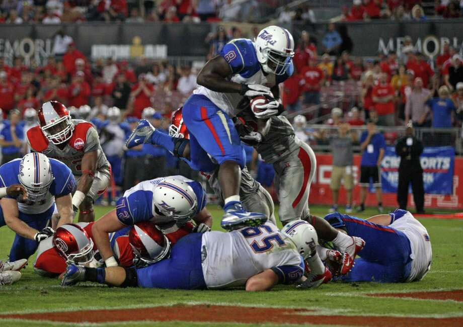 University of Tulsa running back Alex Singleton (8) leaps into the end zone for his second touchdown during the first half of a college football game against the University of Houston, Saturday, November 10, 2012 at Robertson Stadium in Houston, TX. Photo: Eric Christian Smith, For The Chronicle