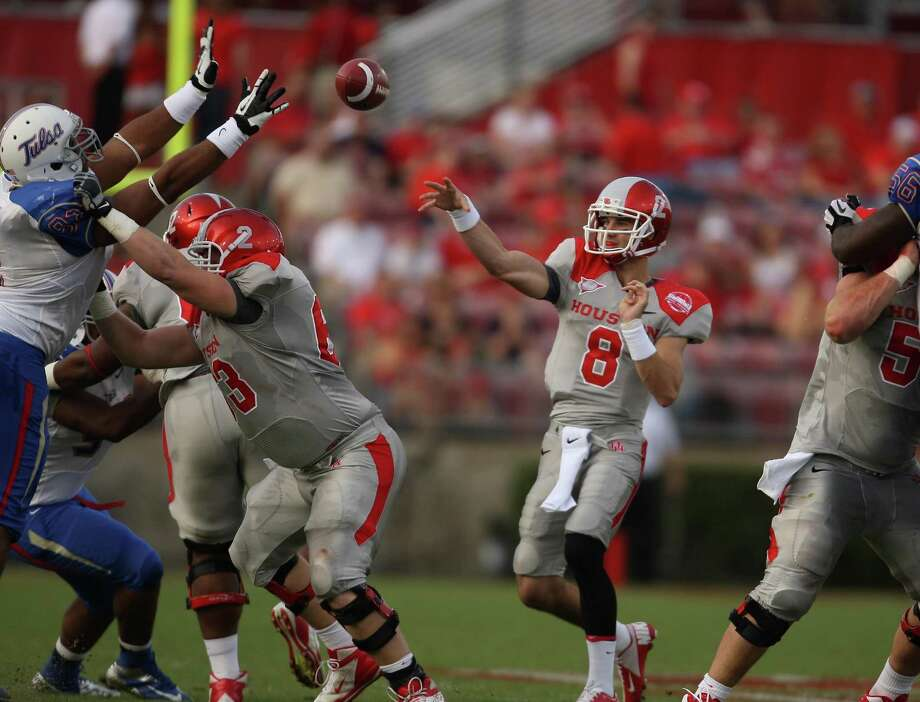 University of Houston quarterback David Piland (8) throws a pass during the first half of a college football game against the University of Tulsa, Saturday, November 10, 2012 at Robertson Stadium in Houston, TX. Photo: Eric Christian Smith, For The Chronicle
