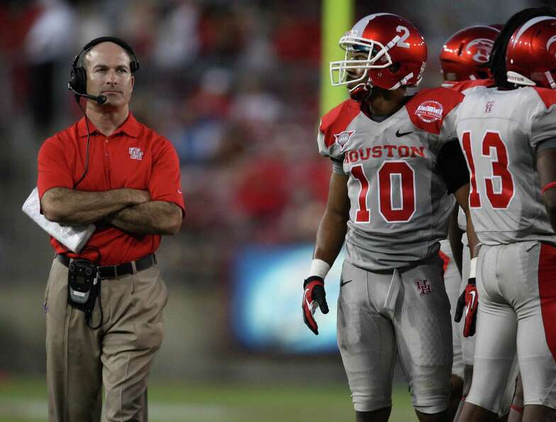University of Houston head coach Tony Levine watches a replay while a play is under review during th