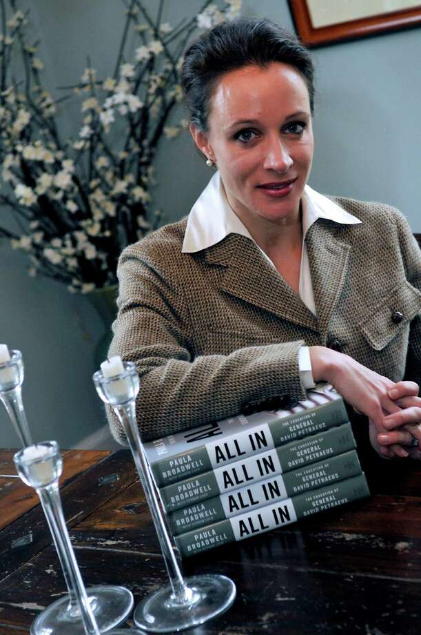 "In this Jan. 15, 2012 photo, Paula Broadwell, author of the David Petraeus biography ""All In,"" poses for photos in Charlotte, N.C. Petraeus, the retired four-star general renowned for taking charge of the military campaigns in Iraq and then Afghanistan, abruptly resigned Friday, Nov. 9, 2012 as director of the CIA, admitting to an extramarital affair. Petraeus carried on the affair with Broadwell, according to several U.S. officials with knowledge of the situation. (AP Photo/The Charlotte Observer, T. Ortega Gaines) LOCAL TV OUT (WSOC, WBTV, WCNC, WCCB); LOCAL PRINT OUT (CHARLOTTE BUSINESS JOURNAL, CREATIVE LOAFLING, CHARLOTTE WEEKLY, MECHLENBURG TIMES, CHARLOTTE MAGAZINE, CHARLOTTE PARENTS) LOCAL RADIO OUT (WBT) Photo: T. Ortega Gaines, MBI / The Charlotte Observer"