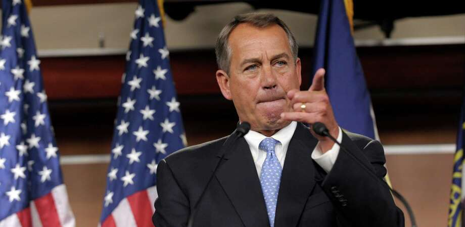 House Speaker John Boehner of Ohio calls on a reporter during a news conference on Capitol Hill in Washington on Friday, The Speaker reportedly has warned House Republicans they must be more flexible on fiscal matters. Photo: Susan Walsh, STF / AP