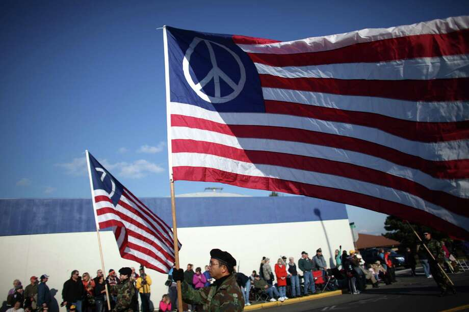 "Members of ""Veterans For Peace"" march in the Auburn Veterans Day Parade. The group was denied entry into the parade by the City of Auburn until a judge ordered the city to allow the group to march on free speech grounds. A few boos were directed at the group and others turned their backs on them as they marched past. However, the parade largely went on as usual. Photo: JOSHUA TRUJILLO / SEATTLEPI.COM"