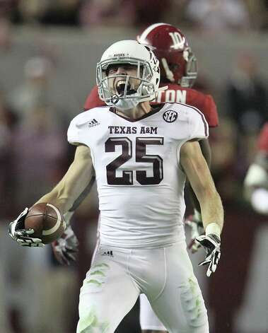 Texas A&M wide receiver Ryan Swope (25) reacts after making a catch during the second half of a college football game at Bryant-Denny Stadium, Saturday, Nov. 10, 2012, in Tuscaloosa. Photo: Karen Warren, Houston Chronicle / © 2012  Houston Chronicle