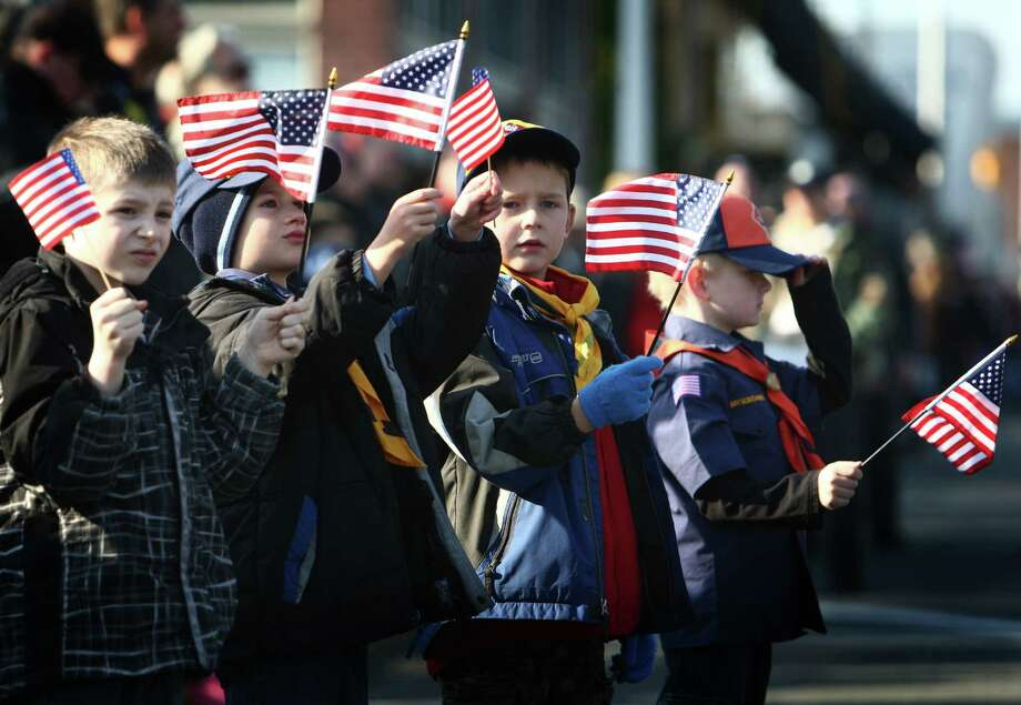 Cub Scouts wave flags during the Auburn Veterans Day Parade. Photo: JOSHUA TRUJILLO / SEATTLEPI.COM