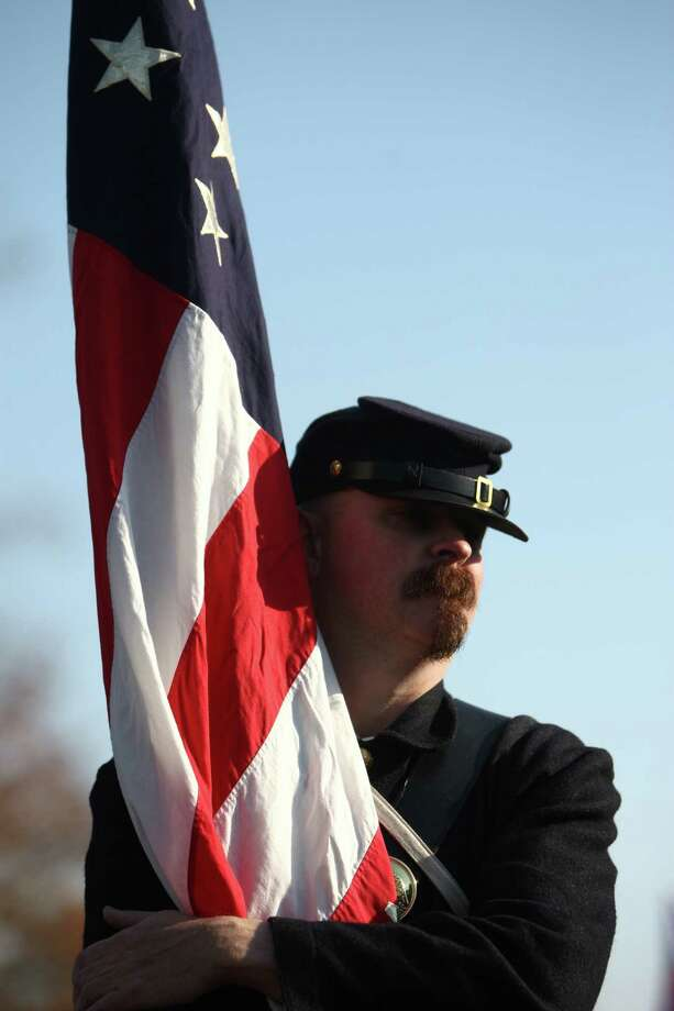 Brad Jones of Seattle's 4th Infantry, Washington Civil War Association, holds onto his flag as he waits to march in the Auburn Veterans Day Parade. Photo: JOSHUA TRUJILLO / SEATTLEPI.COM