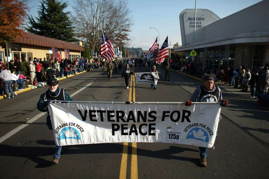 "Members of ""Veterans For Peace"" march in the Auburn Veterans Day Parade. A few boos were directed at the group and some spectators turned their backs on the group as they marched past. Photo: JOSHUA TRUJILLO / SEATTLEPI.COM"