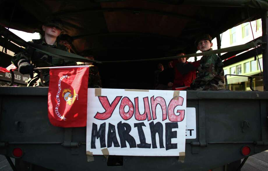Participants in the Auburn Veterans Day Parade ride in a military truck. Photo: JOSHUA TRUJILLO / SEATTLEPI.COM