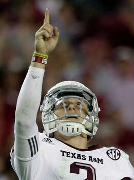 Texas A&M quarterback Johnny Manziel (2) reacts during the second half of an NCAA college football game against Alabama at Bryant-Denny Stadium in Tuscaloosa, Ala., Saturday, Nov. 10, 2012. Texas A&M won 29-24. Photo: Dave Martin, Associated Press / AP