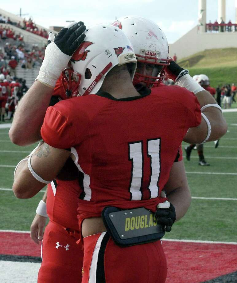 Lamar wide receiver Kevin Johnson is congratulated on a very early touchdown during the Lamar University game against Nicholls State at the Provost Umphrey Stadium on Saturday, November 10, 2012. Photo taken: Randy Edwards/The Enterprise