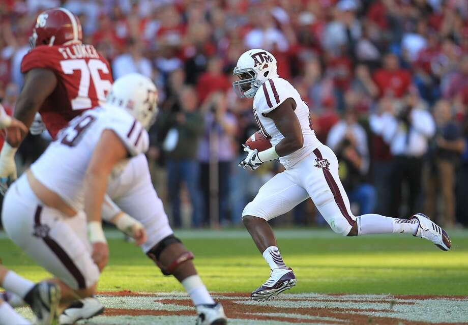 Texas A&M linebacker Sean Porter (10) runs the interception on a pass intended for Alabama wide receiver Kenny Bell (7) during the first quarter of a college football game at Bryant-Denny Stadium, Saturday, Nov. 10, 2012, in Tuscaloosa.  ( Karen Warren / Houston Chronicle ) (Houston Chronicle)