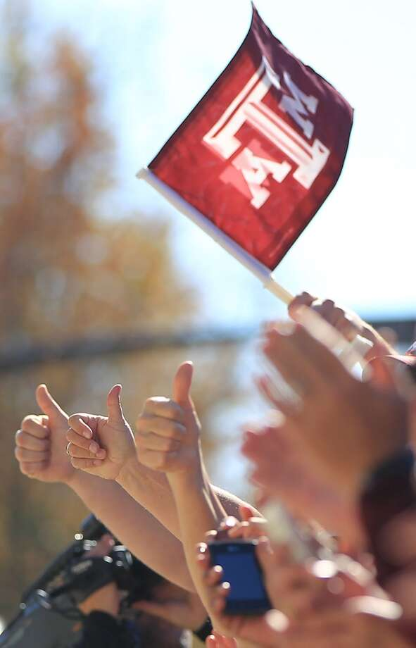 Texas A&M fans cheer as the team arrives on their buses before the start of a college football game at Bryant-Denny Stadium, Saturday, Nov. 10, 2012, in Tuscaloosa.  ( Karen Warren / Houston Chronicle ) (Houston Chronicle)
