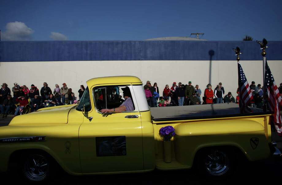 A classic truck drives the route during the Auburn Veterans Day Parade. Photo: JOSHUA TRUJILLO / SEATTLEPI.COM
