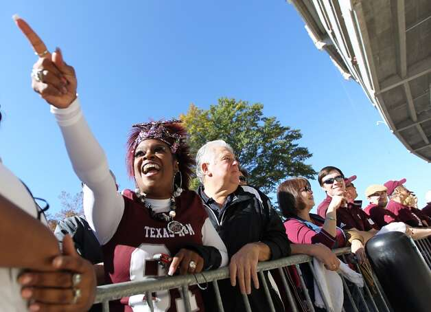 Texas A&M mom, Rochelle Luttrall, of Round Rock, screams as she spots her son, Texas A&M tight end Nehemiah Hicks (81) on the bus before the start of a college football game at Bryant-Denny Stadium, Saturday, Nov. 10, 2012, in Tuscaloosa.  ( Karen Warren / Houston Chronicle ) (Houston Chronicle)