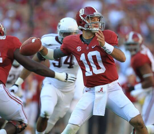 Alabama quarterback AJ McCarron (10) drips back to pass during the first quarter of a college football game at Bryant-Denny Stadium, Saturday, Nov. 10, 2012, in Tuscaloosa.  ( Karen Warren / Houston Chronicle ) (Houston Chronicle)